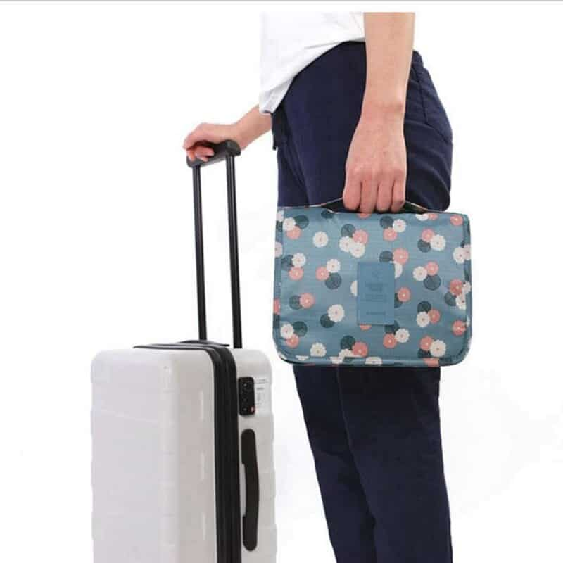 A person holding a piece of luggage